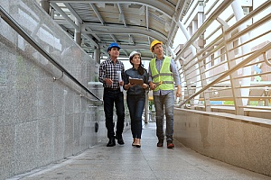 Group of mechanics walking on construction site