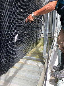 contractor cleaning a cooling tower