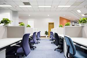 Empty office cubicles with chairs