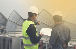 professionals inspeting cooling tower cleaning
