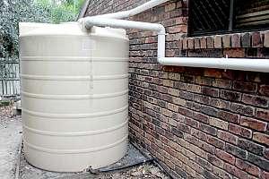 Water tank behind building