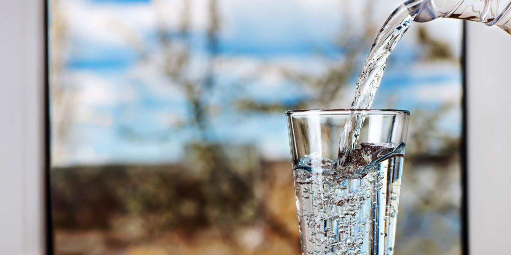 filtered-water-poured-into-a-glass-in-industrial-water-filtration-systems
