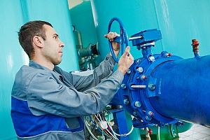 water treatment technology professional working on a pipe drain
