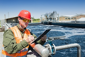 worker examining a water treatment technology at a water plant