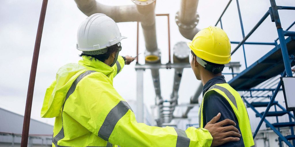 Mechanical engineers from a Water Treatment Consulting firm inspecting work site