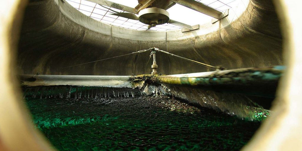 Water inside a cooling tower. Chemicals are use in cooling tower water treatment for variety of purposes