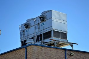 Cooling tower on top of a building. Legionella certificate process includes inspect the cooling towers