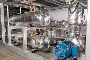 large silver glycol cooling system in a building basement