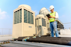 Technician working on cooling tower maintenance