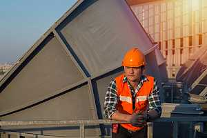 Cooling tower maintenance engineer on a routine maintenance survey