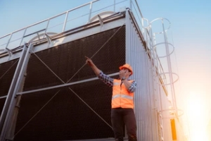 engineer standing near cooling tower