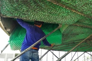 man cleaning a cooling tower to Prevent Legionella